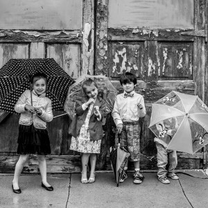 Kids with Umbrellas - Photo by Erin Markan