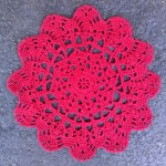 red doily contribution for yarnbomber